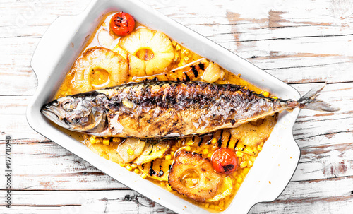 Fototapeta Delicious whole baked fish with pineapple