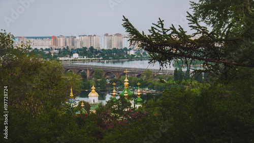 Foto op Plexiglas Kiev Botanical garden with blooming lilac, spring landscape, St. George Cathedral of the Vydubychi Monastery, view on Dnipro river, Kyiv, Ukraine