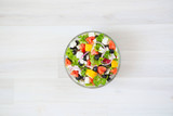Fresh vegetable salad with feta cheese, fresh lettuce, cherry tomatoes, red onion and pepper - 197731586