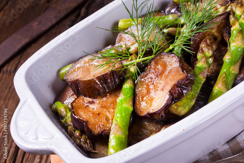 Fototapeta Eggplant casserole with green asparagus