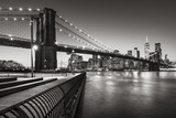 Brooklyn Bridge Park boardwalk in evening with the skyscrapers of Lower Manhattan, East River, and the Brooklyn Bridge in Black & White. Brooklyn, New York City - 197757775