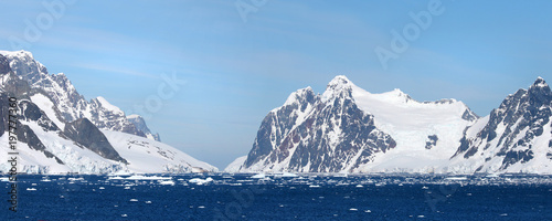 Fotobehang Antarctica Antarctic ocean, Antarctica. Glacier Snow Covered Mountain. Dramatic blue Sky background. Two Photo Pano stitch.