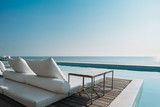 Beautiful luxury swimming pool on sea view and beach chair in hotel resort - 197779395
