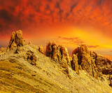 mountain chain on a red dramatic sunset background