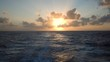 Wake behind an ocean going cruise ship at sea with sunset