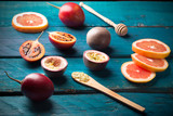 passion fruit and tamarillo on wooden table