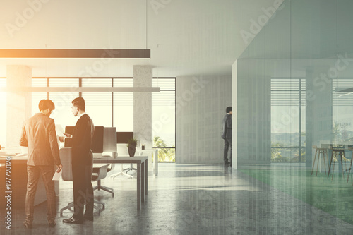 Front view of an open space office toned