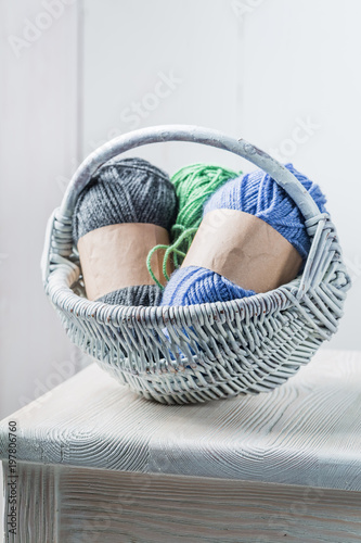 Colored wool in vintage white wicker basket