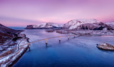 Bridge and high mountains during sunset. Natural landscape in the Norway