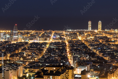 Fotobehang Barcelona Views of Barcelona, Spain, at night. The streets are illuminated and te Mapfre towers are outstanding at the back.