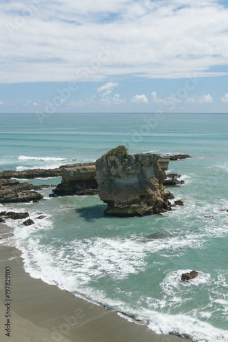 Foto Spatwand Cathedral Cove Breaking rock on sea shore over Tasman sea New Zealand natural landscape background