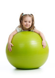 Smiling pretty kid girl with fitness ball. Isolated on white background.