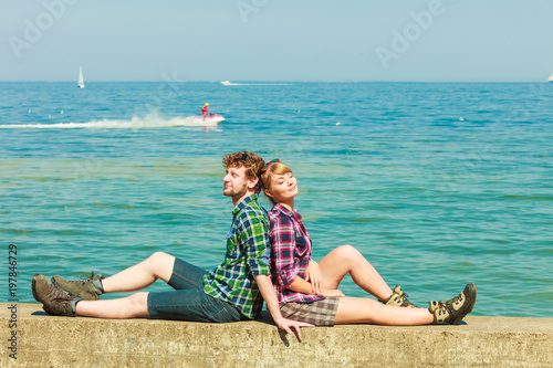 hiking couple relaxing on sea coast