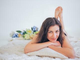 Young brunette model posing naked
