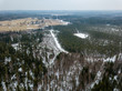 drone image. aerial view of rural area with forest road in winter