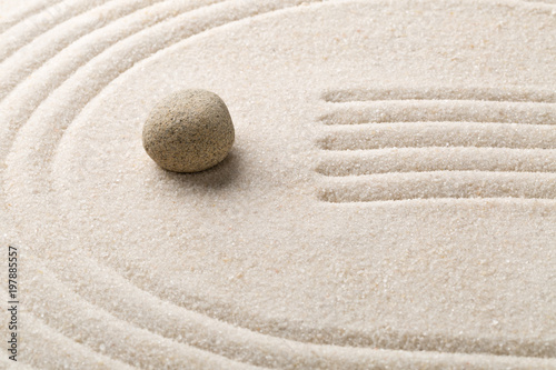 Fotobehang Stenen in het Zand Zen sand and stone garden with raked lines and curves. Simplicity, concentration or calmness abstract concept