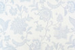 Leinwanddruck Bild - Blue ornate floral pattern on white cotton tablecloth.