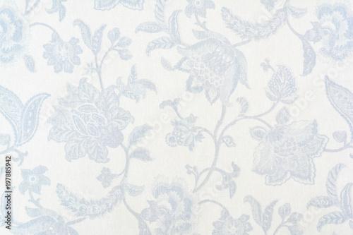 Leinwanddruck Bild Blue ornate floral pattern on white cotton tablecloth.