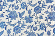 Leinwanddruck Bild - Blue ornate floral pattern on white cotton tablecloth.