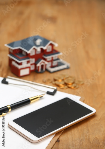 house model,calculator,pen,and coins on wooden table - 197891566