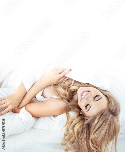 Fotobehang Artist KB Pretty, sensual blonde relaxing in the bright bedroom