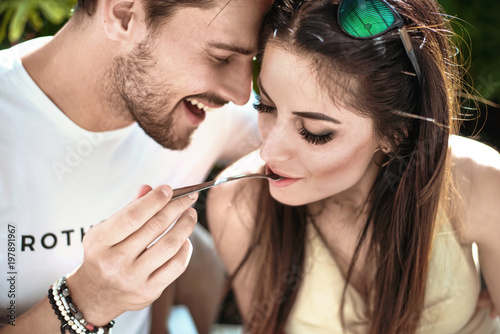 Fotobehang Artist KB Portrait of a cheerful couple eating a lunch
