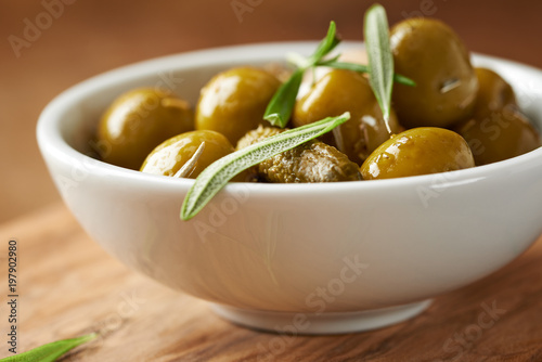 Pickled green olives and gherkins. Close up. Horizontal.