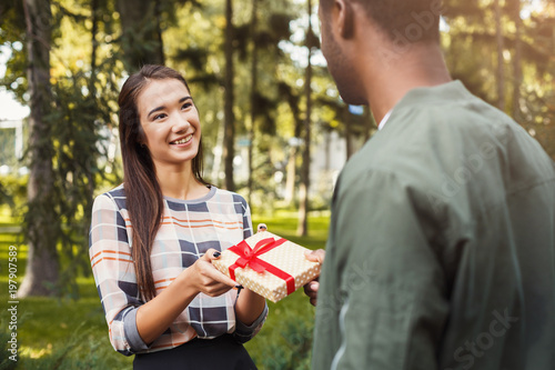Man surprising his girlfriend with gift Poster