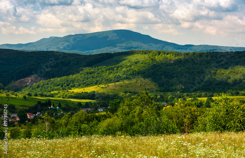 village in the valley of Carpathian mountains. beautiful summer scenery on a cloudy day - 197916743