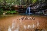 stacked stones on waterfall (chapada dos veadeiros)