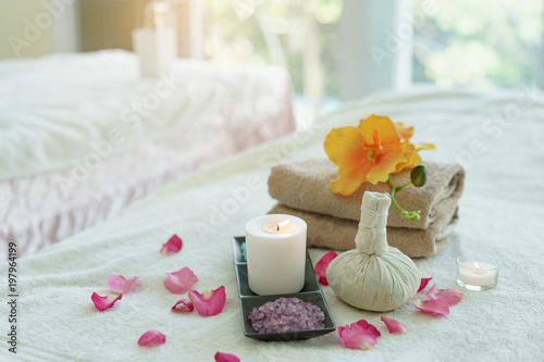 Beauty and fashion concept with spa set.Spa feet and hand thai massage compress balls,herbal ball on the wooden with treatments spa,summer day,Thailand. © iseeu2_2
