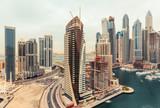 Spectacular view on Dubai Marina creek with skyscrapers. Scenic skyline.
