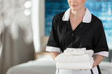 Young maid with towels
