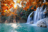Scenic of nature Beautiful Waterfall with sunlight in autumn forest at Erawan  National Park, Thailand ,Travel amazing asia