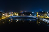 Aerial night drone view on Grunwald Bridge over Odre river in Wroclaw
