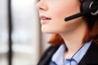 Close up of unrecognisable woman speaking in the headset. Telemarketing and customers support