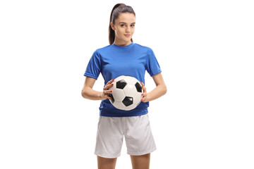 Female soccer player holding a football