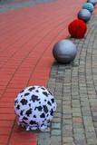 Street pavement with ornamental metallic balls