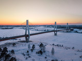 sunset in winter. Bridge over river. the sun will want. river in ice