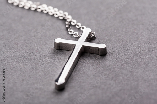Silver cross on a gray background - 198069556