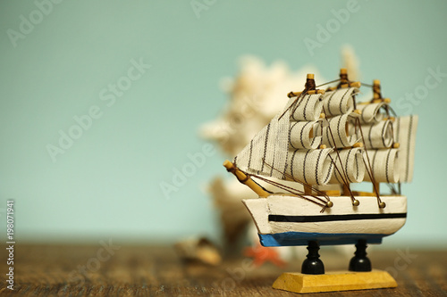 Foto op Plexiglas Schip Old wooden ship with sails and masts toy on a stand. Vintage and