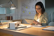 Architect woman in office working on digital tablet