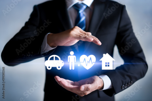 Businessman with protective gesture and car, family, life and health insurance icons. Insurance concept. - 198080368
