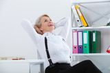 Woman relaxing. Woman dreams in his chair in office and enjoying the view from window - 198083133