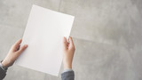 Person holding white empty paper - 198091368