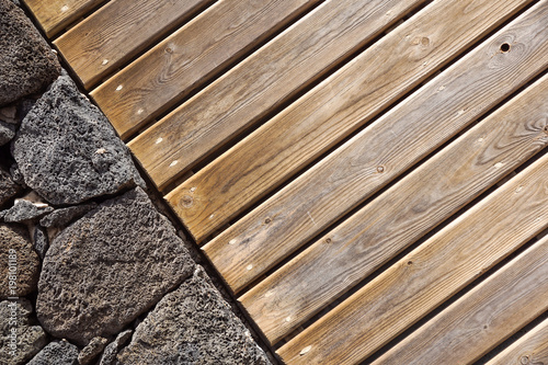 Stone wall background. stone and wood wall, wood texture as background. Wood background wall . - 198101189