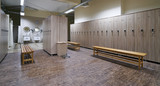 Locker room with wood benches and wooden lockers in the gym - 198102368