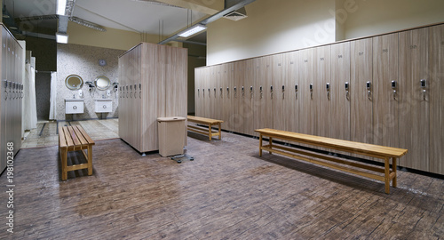 Locker room with wood benches and wooden lockers in the gym buy