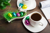 Chocolate eggs dessert with coffee, Easter morning concept