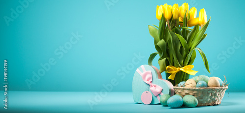 Yellow tulips on blue background